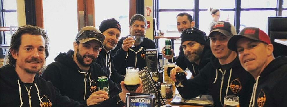 The team enjoys some celebratory beers and coffee