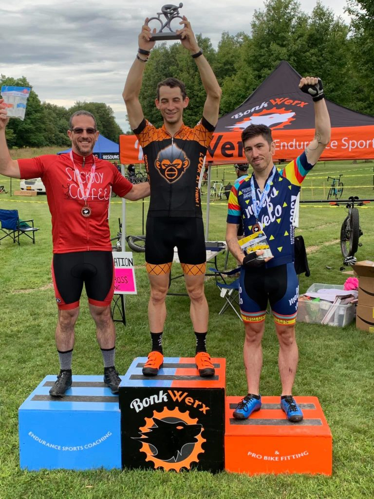 Jon Cyganik stands on top of the podium in the CAT 5 race at Bonkwerks Cyclocross