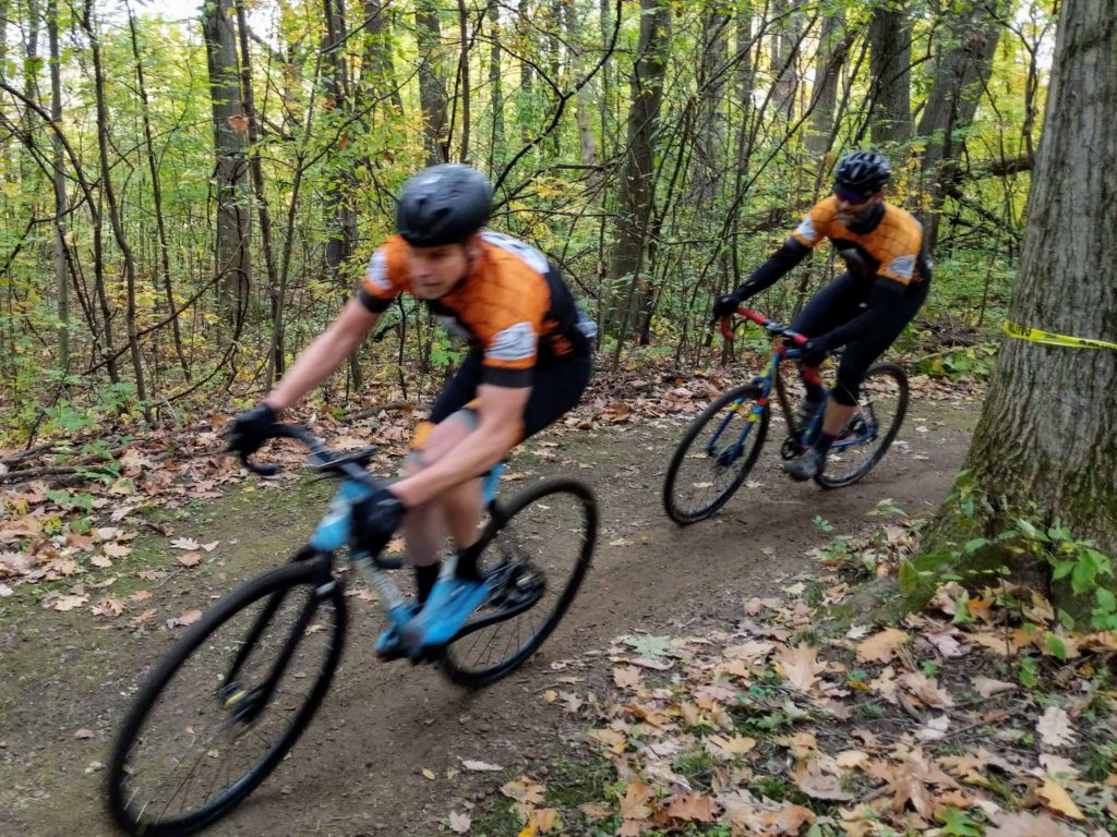 Rob Chimento and Dan Deemer racing through the woods at Long Branch Park