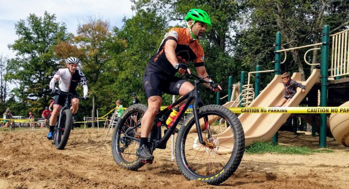 Ben tackles the sand pit on his fatbike at Cross Out Child Abuse 2019