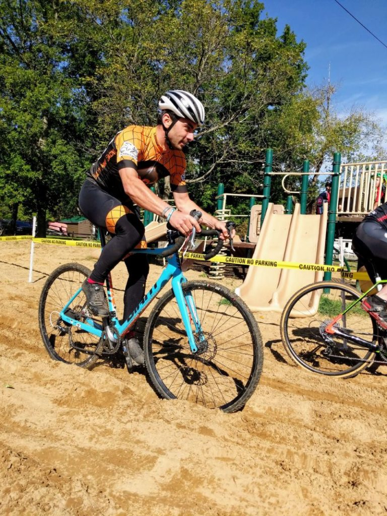 Ken tackles the sand pit at Cross Out Child Abuse 2019
